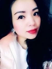 Asian woman Minyi from Jinghe, China
